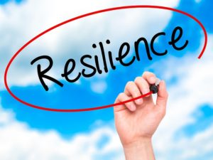 Man Hand writing Resilience with black marker on visual screen